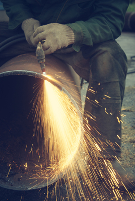 Welder working with sparks